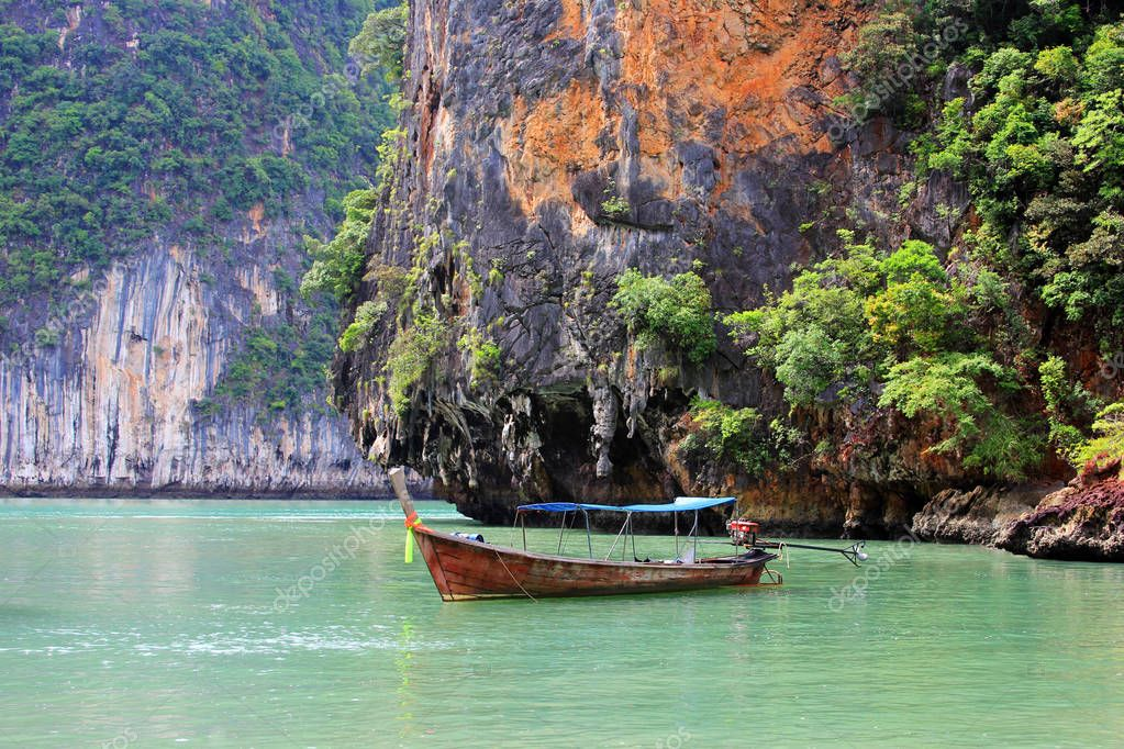 Thai traditional wooden longtail boat and beautiful ocean