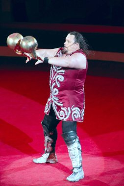 Gomel / Belarus - May 20, 2018 : Strong man showing tricks with weights on arena of circus