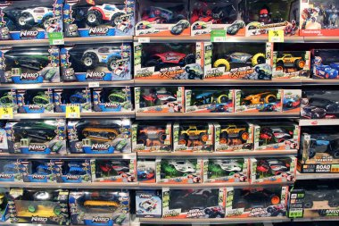 Kyiv / Ukraine. 28 September 2018: Shop toys. Toy store. Inside toy shop. Rows of shelves with toys. Children's joy. Wide selection of toys in children's store. Shop for children. Cars for boys. Inside toy shop of model cars