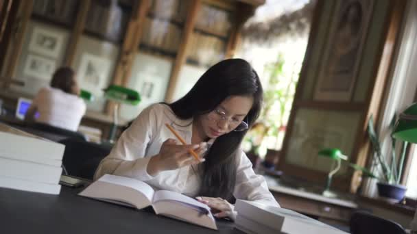 Attractive young woman is writing, reading book for lawyer