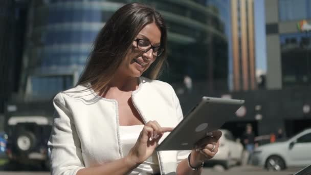 Young banker chief businesswoman in glasses and white jacket