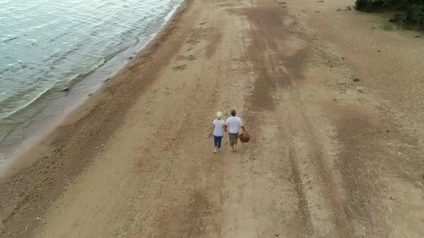 Carefree mature caucasian family enjoying weekend on seaside.
