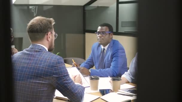 Group of multiracial people discussing financial strategy on briefing in modern office.