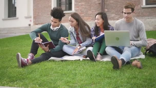 Group four students doing new job, talking, sitting on campus background.
