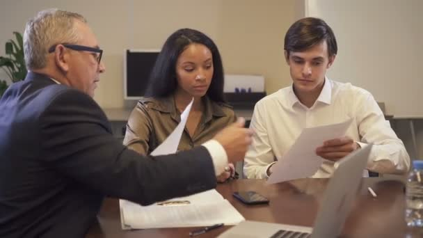 Hispanic woman discuss with lawyer and banker about important contract.