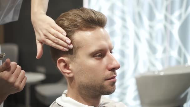 Female master is doing attractive formal haircut for important event