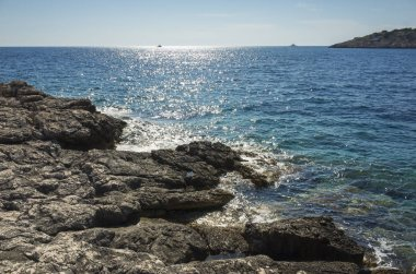Beautiful nature and landscape photo of sunny summer day at Adriatic Sea in Dalmatia, Croatia, Europe. Nice outdoors at Mediterranean coast. Calm, peaceful and happy picture.