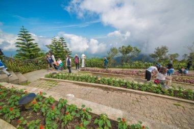 Tourists looking at Sunworld Ba Na Hills Park in Vietnam, Da Nang stock vector