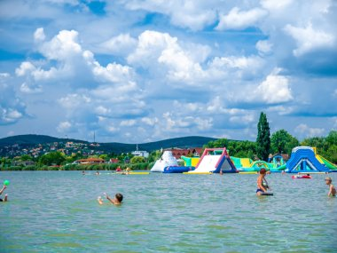 View on the people swimming and playing in the Velence lake in V