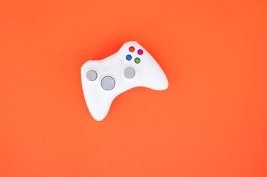 Gamepad is isolated on a red background. Gaming competition. White joystick on red background. Gamer concept. Controller for video games. stock vector