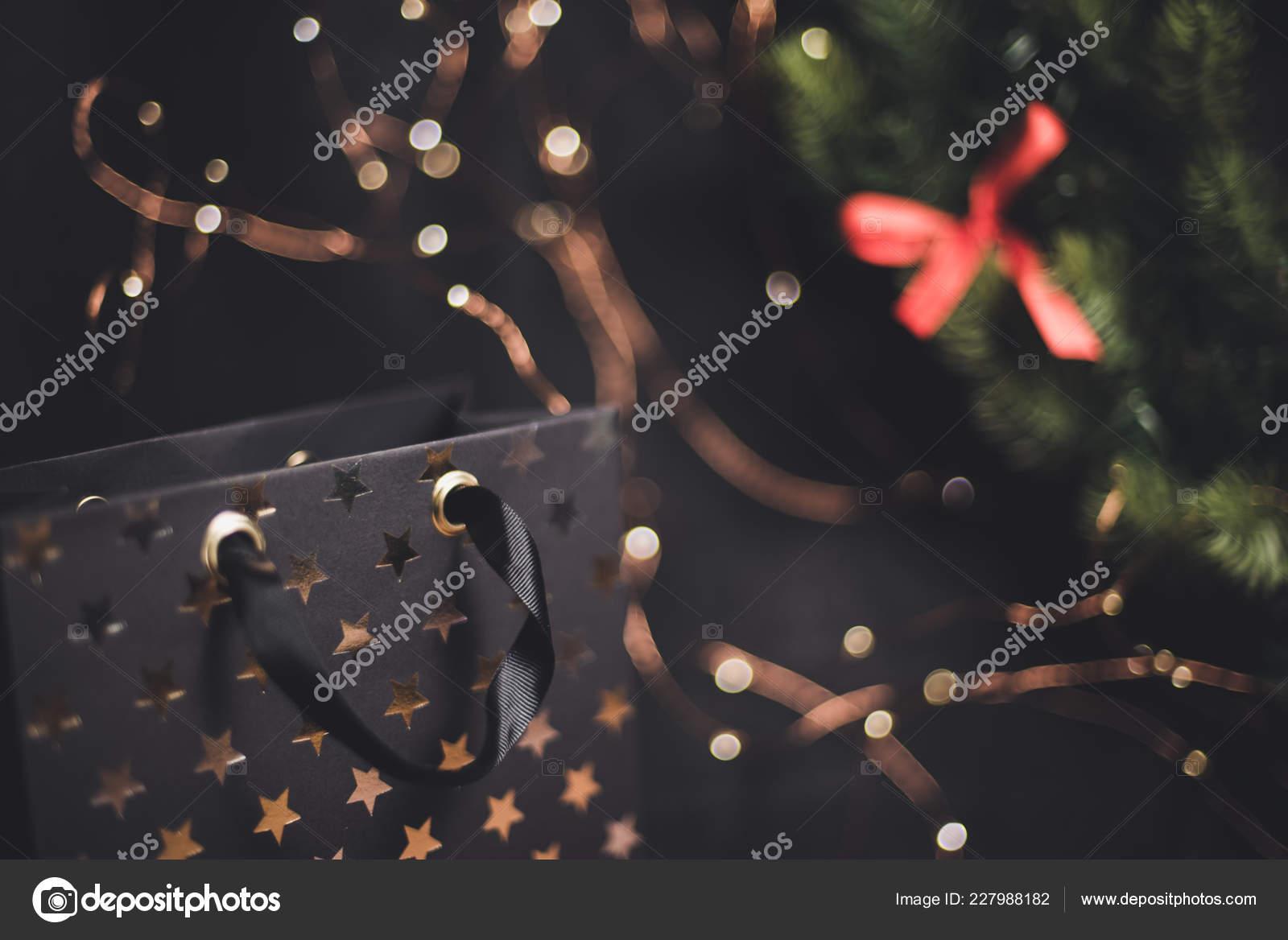 dark new year background gift wreath red ribbon stock photo
