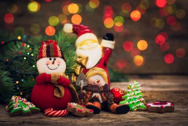 festive winter holiday decorations and baked cookies on wooden tabletop