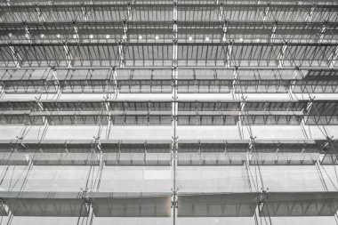 Steel structure roof of office building. Windows glass facade supported. Abstract architecture fragment background.