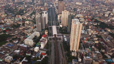Aerial view of BTS skytrain of Krung Thonburi district, Sathorn road in financial district and skyscraper buildings. Bangkok city. Downtown area, Thailand.