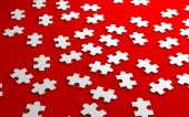 Jigsaw puzzle, pattern texture separated in strategy and solution business concept on red background. 3d abstract illustration