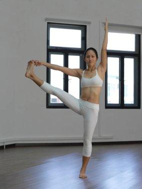 Asian chinese single woman in white practising Yoga