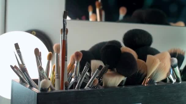 Professional cosmetics makeup brushes kit in motion