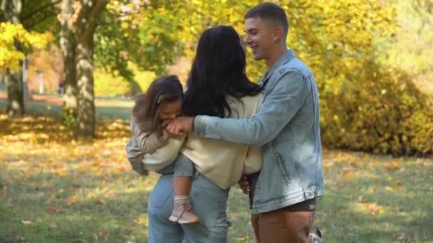 Happy family in autumn park. Happy family concept. Fall