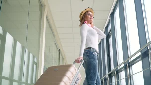 Travelling girl with his luggage while waiting for transport