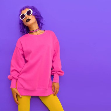 Life is colorful. Fashion Lady with purple hair and bright stylish trends outfit