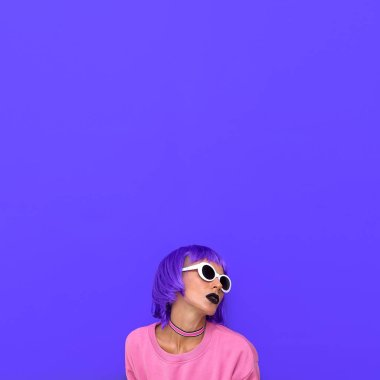 Stylish girl with purple hair. Colorful fashion style. Life is colour