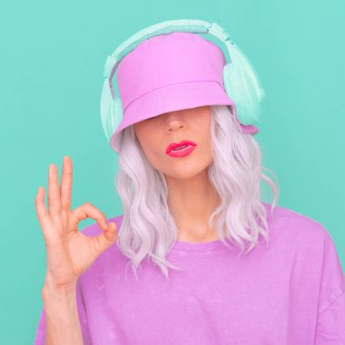 Fashion Dj Girl in stylish headphones and bucket hats. Minimal monochrome pastel colours design trends