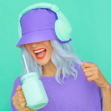 Happy Smoothie Dj Girl in stylish headphones and bucket hats. Minimal monochrome pastel colours design trends