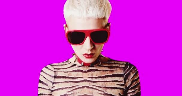 Animation gif design. Portrait stylish freak girl with choker and sunglasses on pink background