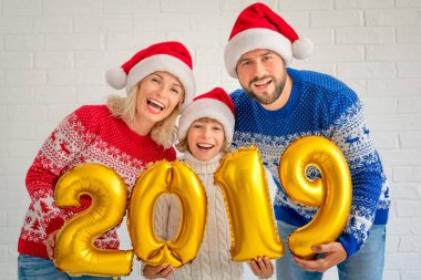 Happy family holding numbers 2019. People celebrating New Year holiday