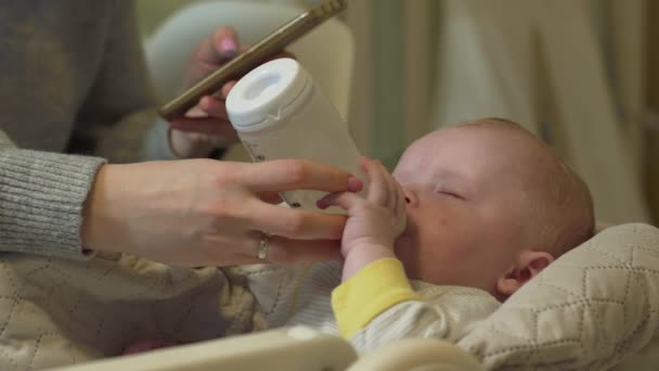 Mother Phone Feeds Baby
