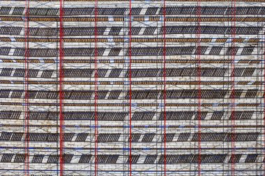 Abstract geometric composition background. Scaffolding on building, metal structures
