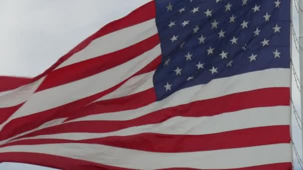 Steady close up shot of United States flag waving in the wind