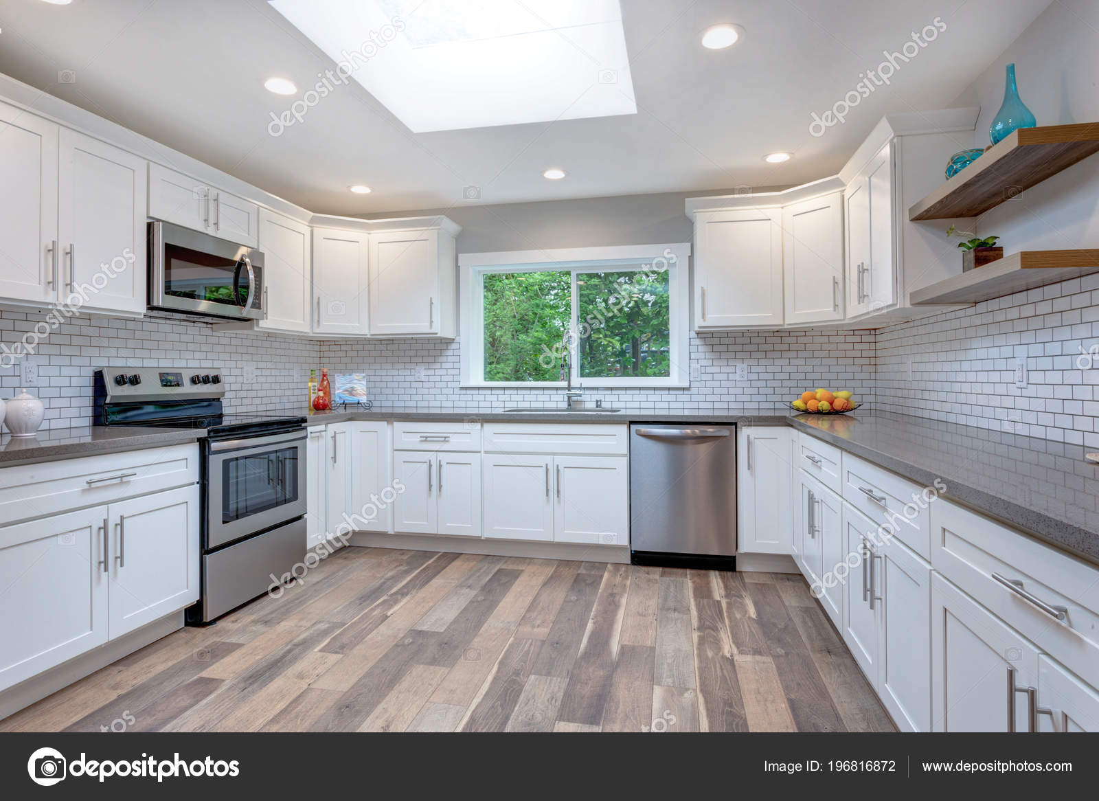 Open Concept Kitchen White Cabinets Grey Quartz Countertops Tile