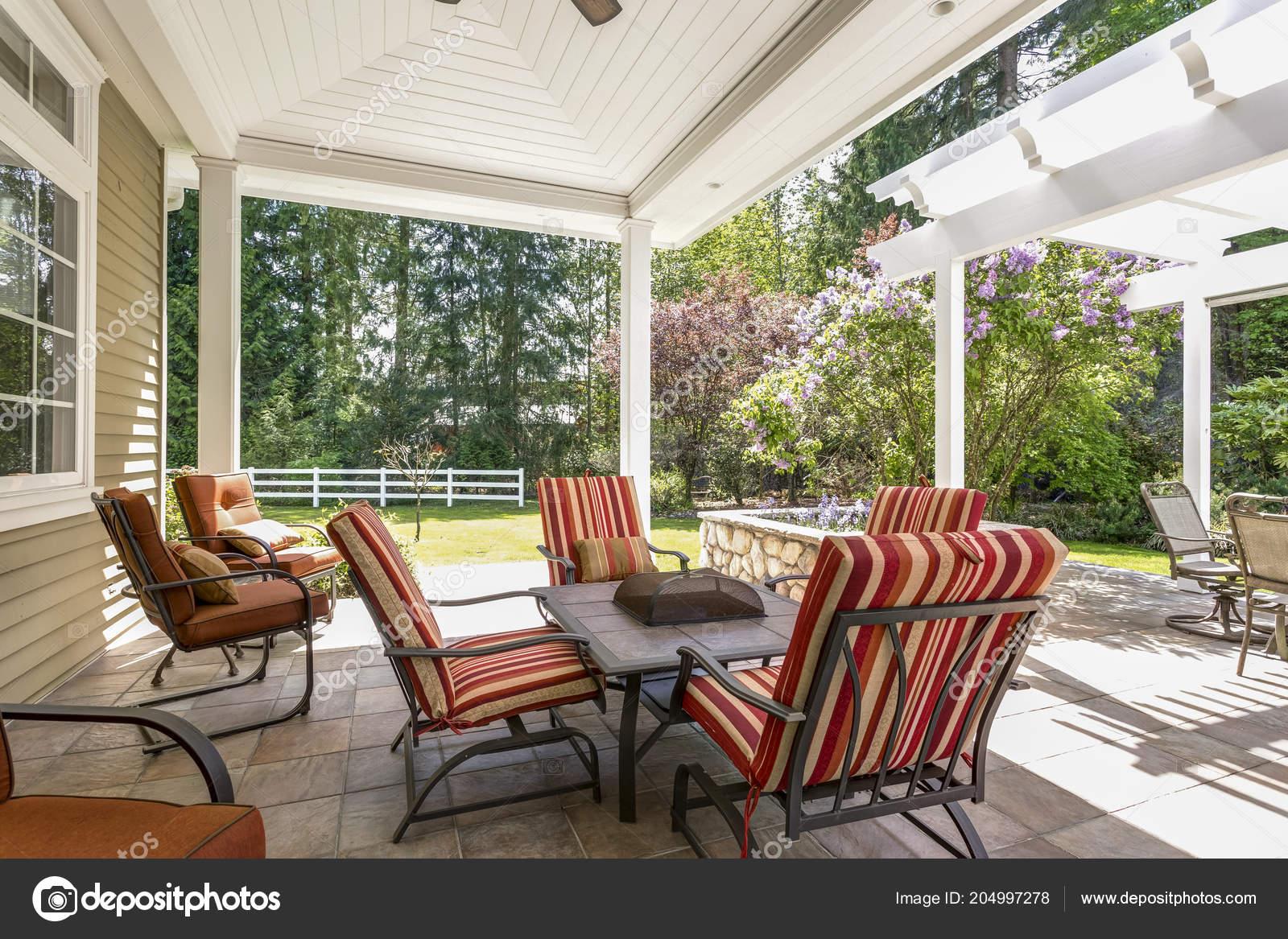 https depositphotos com 204997278 stock photo spacious covered deck area table html