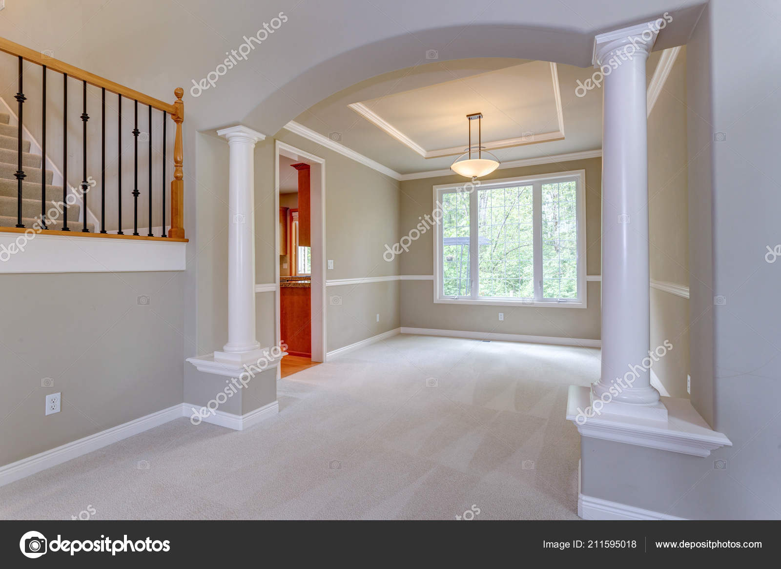 Elegant Arched Entryway Empty Dining Room Accented White Columns Stock Photo
