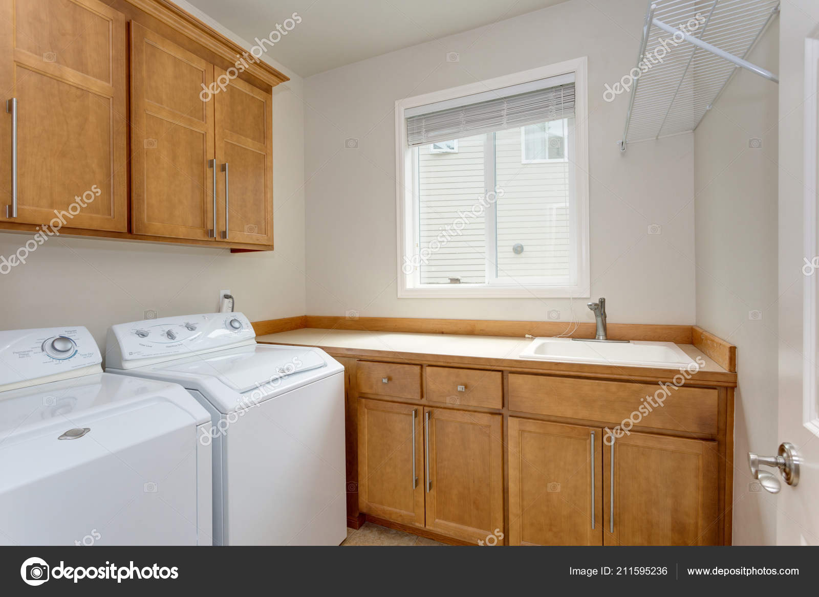 Small Bathroom With Washer And Dryer Ideas Small Laundry Room Light Brown Cabinets White Washer Dryer Stock Photo C Alabn 211595236
