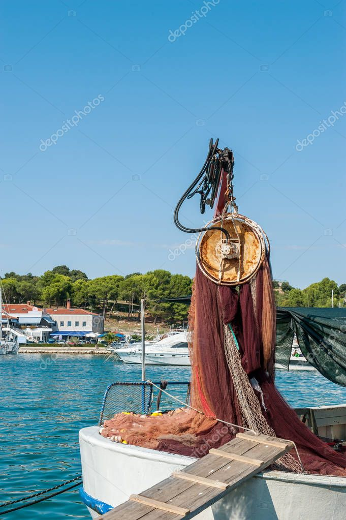 fishing nets raises the crane on the pier by the sea. Fish products. Repair of networks