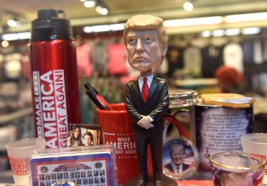 New York, USA - May 31, 2018: Donald Trump bobble head other souvenirs in the gift shop in New York.