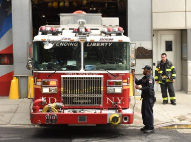 New York, USA - June 10, 2018: Firefighters and fire truck near the FDNY Ten House on Liberty Steet on lower Manhattan.
