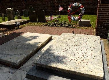 Benjamin and Deborah Franklin grave covered in coins at Christ Church Burial Ground in Philadelphia, PA, USA