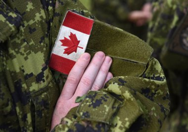 Canada patch flag on soldiers arm