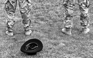 US troops. US army. soldiers legs and hat on the grass.
