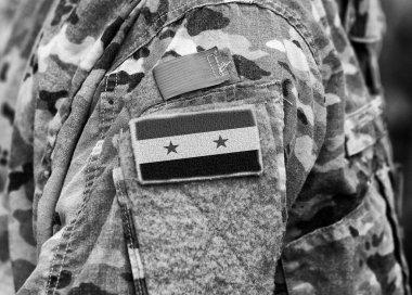 Syrian flag on soldiers arm. Syria army. Syrian troops.