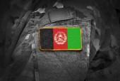 Fotografie Flagge Afghanistans auf dem Arm der Soldaten (Collage).