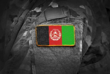 Flag of Afghanistan on soldiers arm (collage).