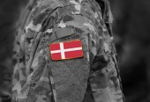 Fotografie Flag of Denmark on soldiers arm. Flag of Denmark on military uniforms (collage).