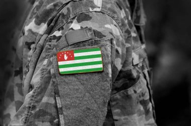 Flag of Republic of Abkhazia on soldiers arm. Flag of Abkhazia on military uniforms (collage).