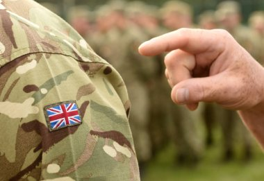 UK flag on soldiers arm. UK military uniform.