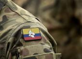 Fotografie Flagge der Revolutionären Streitkräfte Kolumbiens (Farc) auf Militäruniform.