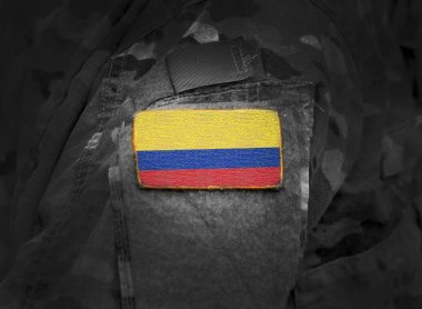Flag of Colombia on soldiers arm (collage).
